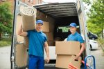 movers holding house items
